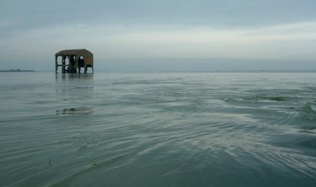 l'ex magazzino del riso nella Sacca della Bottonera  con marea crescente.